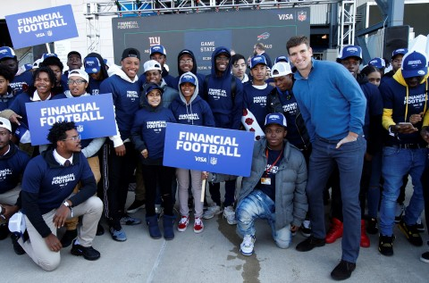 NFL players Saquon Barkley (front, fifth from the left) and Eli Manning (front, second from the right) partner with Visa to launch Financial Football video game. The free video game lets fans ages 11 and older suit up as a player from their favorite NFL team and play a virtual game of football designed to help students learn to make smart money-management decisions. (Photo: Business Wire)