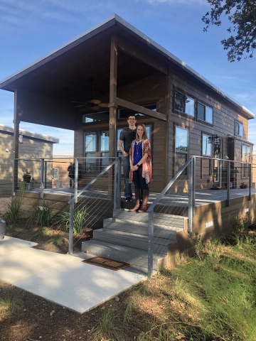 "Preston and Sarah Cox recently sold their single family home in Georgetown, TX and purchased a tiny home at Village Farm. Reducing debt and living mortgage free has allowed them more time to do the thing they love most, travel. The past several years the Cox have begun to ""live a more minimalistic, simple, and intentional lifestyle, and were inspired this past summer after watching ""Minimalism: A Documentary About the Important Things."" (Photo: Business Wire)"