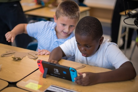 In this photo provided by Nintendo of America, third-grade students at the Lake Hiawatha Elementary School in Lake Hiawatha, New Jersey, participate in an interactive learning session with the Nintendo Labo: Variety Kit for the Nintendo Switch system. On Oct. 23, Nintendo and the Institute of Play announced a partnership to bring Nintendo Labo kits into elementary classrooms nationwide. The program combines the innovative play of Nintendo Labo with the basic principles of science, technology, engineering, art and mathematics (STEAM) to inspire kids and help make learning fun.