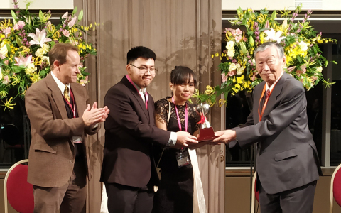 Dr. Masahiro Katoh (Chairman, Edogawa Hospitals) awarding the Fujio Cup to Mr Tommy and Ms Grace (Bandung Institute of Technology, Indonesia), in the presence of Dr Ian Gallicano (George Town University). (Photo: Business Wire)