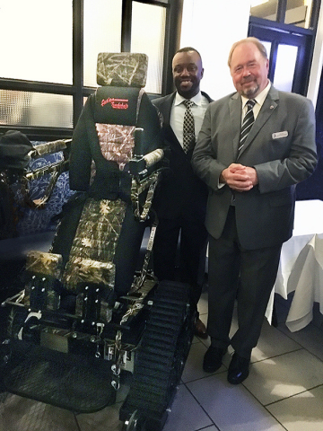 Dave Mann, Senior Vice President of Operations at NTS, donates the TrackStander to Willie Jordan, the Charitable Organizations Program Manager for the Wounded Warrior Regiment. (Photo: Business Wire)