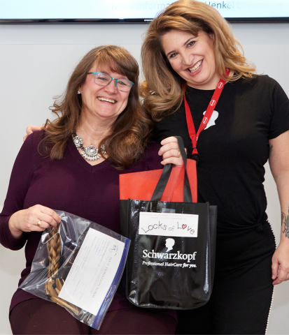 Henkel employee Julie O'Grady (left) with Henkel stylist Wendy Gutkin, was one of nine employees to participate in the Schwarzkopf Million Chances hair donation event. (Photo: Business Wire)