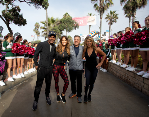 Sugar Ray Leonard, Brooke Burke and Denise Austin join Skechers president Michael Greenberg at the 10th Annual Skechers Pier to Pier Friendship Walk in Manhattan Beach, California. The Walk raised more than $2 million for children with special needs and schools. (Photo: Business Wire)