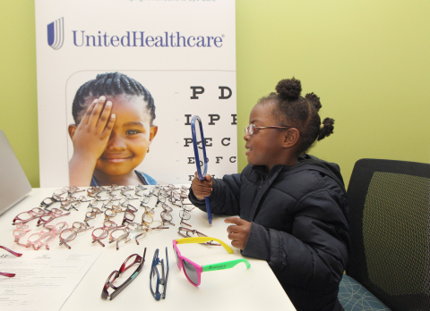 Victoria (age 5) admires new glasses she received during free vision screenings and comprehensive eye exams for students at Sheltering Arms schools in Atlanta. The event was part of a grant program from UnitedHealthcare to nonprofits in cities across the country to coordinate free vision screenings, comprehensive eye exams and eyeglasses donations. Prevent Blindness Georgia received a $5,000 grant for the event (Photo: Tami Chappell).