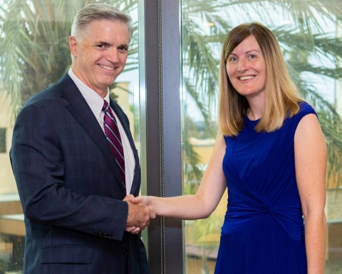 The Institutes President Peter Miller congratulates GEICO's Rachel Holt for earning an Academic Exce ...