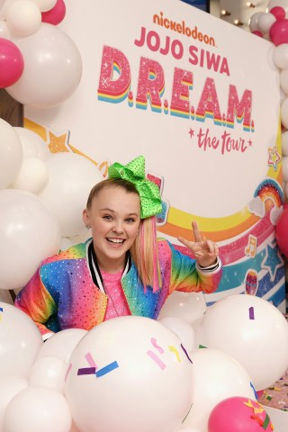 Nickelodeon star and YouTube sensation JoJo Siwa today surprised fans at Sugar Factory in New York City with the news that she is embarking on her first multi-city, live stage tour: Nickelodeon's JoJo Siwa D.R.E.A.M. The Tour. The tour, which kicks off on May 17, is produced by Nickelodeon and AEG Worldwide. She will also be releasing her first-ever EP, entitled D.R.E.A.M The Music, featuring four new songs. The full EP is available on Nov. 16 on all digital service providers. Photo Credit: Noam Galai