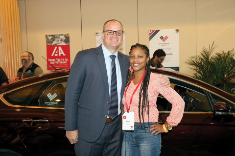 Brian Kaner, president of service for Pep Boys and Icahn Automotive, greets Dionna Nims, one of many U.S. military veterans who received a refurbished vehicle through Progressive's Keys to Progress program. (Photo: Business Wire)