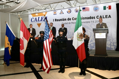 Members of the Mexican Federal Police Honor Guard present flags of the four countries (United States, Mexico, Canada, and Barbados) currently participating in CALEA accreditation during the Inaugural Ceremony of the 1st CALEA Commissioners Meeting in Mexico City, MX. (Photo: Erica Richardson/Police Foundation)