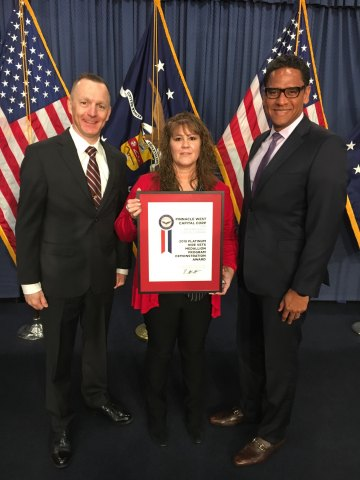 Arizona Public Service and its parent company, Pinnacle West Capital Corp., have been awarded the HIRE Vets Medallion by the U.S. Department of Labor for its commitment to veteran careers. The program, which has rigorous criteria, is based on requirements of the HIRE Vets Act signed by President Trump in May 2017 and recognizes employers' commitment to veteran careers, including hiring, retention and long-term development. The Department announced that 2018 would be a demonstration of the program, prior to full implementation in 2019. APS employees – and U.S. military veterans – Paul Rose (Navy), Carmen Sparkman (Army) and Ray Brooks (Marine Corps) accepted the award on APS' behalf at a ceremony held Thursday, Nov. 8 in Washington D.C. (Photo: Business Wire)