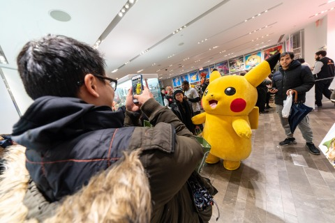 In this photo provided by Nintendo of America, Pikachu celebrates with fans who lined up to be among the first to purchase the Pokémon: Let's Go, Pikachu! and Pokémon: Let's Go, Eevee! games at the Nintendo NY store on Nov. 16, 2018. The immersive Poké Ball Plus accessory that can be used to play the games also hit stores on Nov. 16. (Photo: Business Wire)