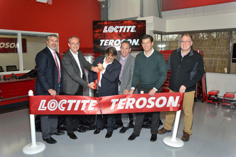 Leaders from Henkel's General Industry division cut the ribbon to officially open the customer train ...