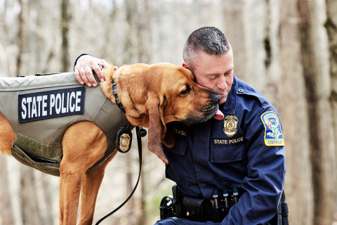 Connecticut State Trooper Anuszewski and K9 Texas wearing protective vest donated by Vested Interest ...