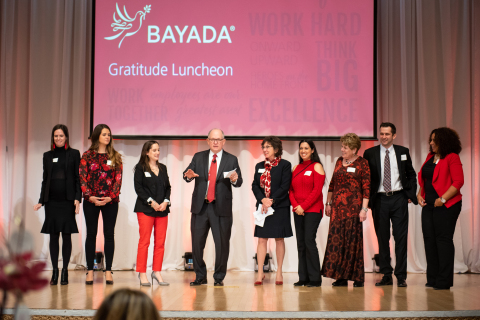 BAYADA Home Health Care founder Mark Baiada and his wife, Ann (center) announce a $20 million gift to employees (Photo: Business Wire)