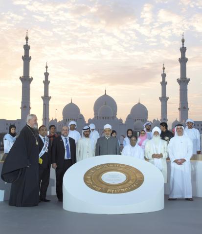 Saif bin Zayed, Khalifa bin Tahnoun, alongside religious and spiritual leaders in front of a memoria ...