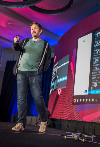 XYO Network CEO and co-founder Arie Trouw on stage at Spatial Summit by XYO during the groundbreaking drone-based demo (Photo: Business Wire)