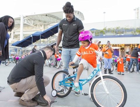 Rally Health and Los Angeles Chargers running back Melvin Gordon gift new bicycles to 100 children from Falcons Youth and Family Services at the third annual Rally Health Holiday Bike Build at the StubHub Center. (Photo: Rally Health)