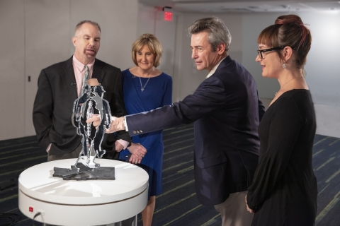 Steve and Leslie Peters, Dr. Matthew Stern and Julie B. examine the art. Dr. Stern, a movement disor ...