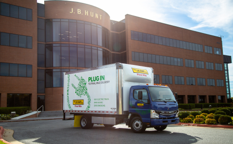 J.B. Hunt has added five FUSO eCanter all-electric medium-duty box trucks to its private fleet, the first ever in company history. J.B. Hunt revealed two of five custom eCanter trucks today during an event at the company's headquarters in Lowell. (Photo: Business Wire)