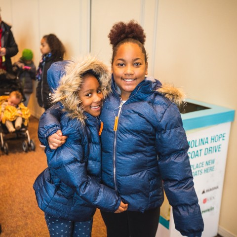 Recipients of new coats at a previous Molina HOPE Coat Drive event in Michigan. (Photo: Business Wir ...