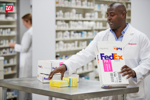 Walgreens pharmacy staff member preparing prescriptions for delivery with FedEx (Photo: Business Wir ...