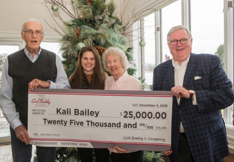 """Tom Buddig, right, Vice President of Marketing, Carl Buddig and Company presents Kali Bailey, second from left, of Nashville, Tenn. with a check for $25,000 dollars as they stand with Bailey's grandparents, Clyde and Ruth Nehrenz of Sullivan, Oh., Tuesday, Dec. 4, 2018 in Ashland, Ohio. Carl Buddig and Company, celebrating its 75th anniversary, sponsored a """"Thanks to the Meal Makers"""" video contest won by Bailey. The video, made by Bailey, honored her grandmother. (Photo: Business Wire)"""