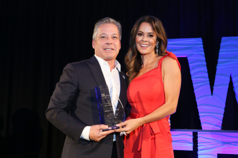 Skechers president Michael Greenberg and presenter Brooke Burke with the T. Kenyon Holly Humanitarian Award at the 79th Annual Two Ten Gala in New York. Photo by Natural Expressions.