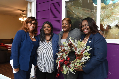 "UnitedHealthcare, SBP, the Baton Rouge mayor's office, and UnitedHealthcare and SBP volunteers hosted a ""Welcome Home"" ceremony for Baton Rouge resident Gladiola Haney, whose home was severely damaged by the Baton Rouge floods of 2016. Sen. Regina Barrow, District 15, East Baton Rouge Parish, presents a door wreath to Ms. Haney and her niece Kelly Stewart. Left to right: Allison Young, CEO, UnitedHealthcare Community Plan of Louisiana; Ms. Haney; Stewart; and Sen. Barrow (Photo: Jeff Strout)."