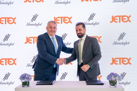 Adel Mardini of Jetex signs with Simon Roads of Honda Aircraft Company (Photo: AETOSWire)