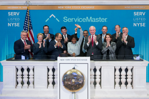 On Dec. 10, the ServiceMaster executive team, including CEO Nik Varty, joined Terminix service technician, Brenda Bell, to ring the bell of the NYSE. (Photo: Business Wire)