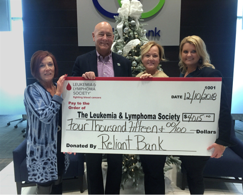 Reliant's management team presenting its donation check to the Leukemia and Lymphoma Society (Photo: ...