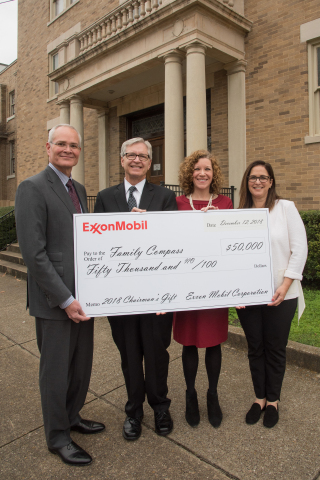 Exxon Mobil Corporation Chairman and Chief Executive Officer Darren Woods presents the company's annual holiday gift of $50,000 to Family Compass, a nonprofit organization dedicated to ending child abuse and neglect through in-home mentoring and life-altering community educational programs. From left to right: Darren Woods, Randy Michero, founding board member of Family Compass, Ona Foster, Family Compass Chief Executive Officer, and Kathy Woods.