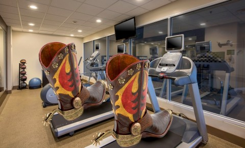 These boots were made for walking — and so are the hotel's treadmills. (Photo: Business Wire)