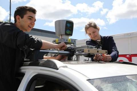 Robert Adragna (left) and teammate, both from University of Toronto, participants in the AutoDrive Challenge. (Photo: Business Wire)