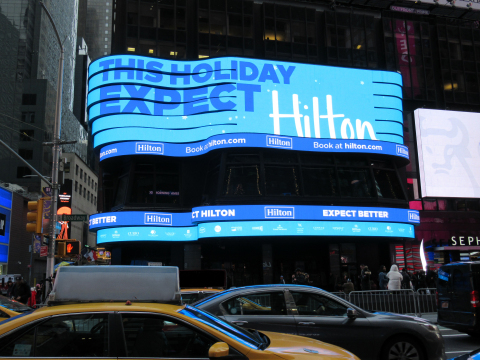 Just in time for the most famous outdoor New Year's Eve gathering in the U.S., Hilton debuts a dynamic, new digital billboard 'takeover' in New York City's Times Square that encourages all travelers, including last-minute New Year's Eve planners, to expect better--with choices like holiday deals and packages plus a host of direct booking benefits to plus-up travel in the New Year. (Intended for news use only.) (Photo: Business Wire)