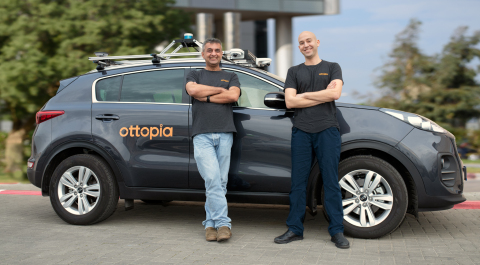 Ottopia's co-founders, Leon Altarac (CTO) and Amit Rosenzweig (CEO) with the company's R&D car. (Photo: Business Wire)