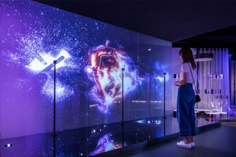 """Create your own custom art piece by interacting with """"The Art of You,"""" a large-scale digital wall in the Future X Smart Store that reads your facial expressions as well as head, eye and mouth movements. (Photo: Business Wire)"""