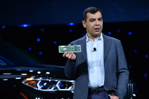 Mobileye President and CEO Prof. Amnon Shashua shows off the EyeQ5 SoC during Intel Corporation's news event at CES 2019 on Jan. 7, 2019, in Las Vegas. The EyeQ5 is Mobileye's fifth-generation system-on-chip for advanced driver assistance systems and automated driving solutions. It is now in production with design wins totaling 8 million units. It comes as Mobileye is fostering a developer ecosystem to expand application development for the EyeQ platform. (Credit: Walden Kirsch/Intel Corporation)