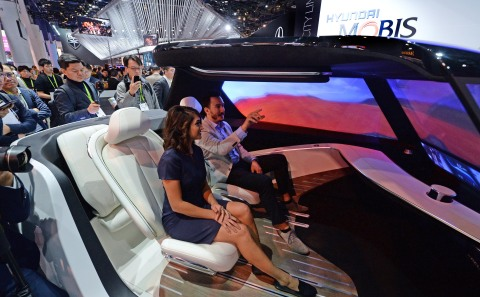 """Hyundai MOBIS showcased the latest Communication Lighting concept at CES 2019. Communication Lighting uses an """"Indicating Lighting Zone"""" to indicate when an autonomous vehicle is operating in self-driving mode. The concept also includes a """"Communication Lighting Zone"""" that uses LED, digital boards, headlamp projection and sound to communicate with nearby pedestrians and vehicles during various driving scenarios--ensuring safer cohabitation. Autonomous vehicles outfitted with Communication Lighting can detect a pedestrian from more than 450 feet away. Upon detection, headlamps being projecting a bright red warning symbol indicating that is unsafe to motion across the self-driving vehicle. In addition to the Communication Lighting Experience Zone, Hyundai MOBIS' new technologies in autonomous driving, Infotainment System and eco-friendly solutions are on display at CES 2019 at Booth 3931 in the North Hall of the LVCC. (Photo: Business Wire)"""