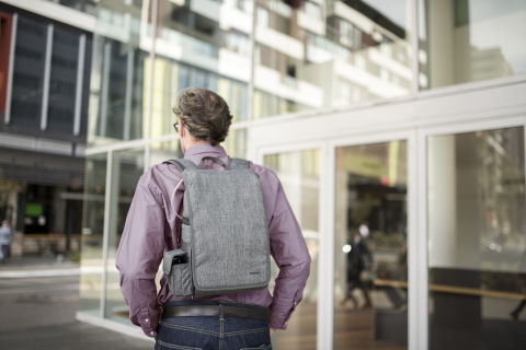 Man walking with ResMed Mobi portable oxygen concentrator (Photo: Business Wire)