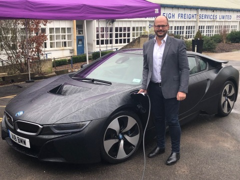 Adam Bond, AFC Energy CEO, charges BMW i8 with world's first fuel cell EV charging system at event in Dunsfold Park, Surrey, (Photo: Business Wire)