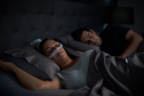 Woman sleeping on side with AirFit N30i nasal CPAP mask (Photo: Business Wire)