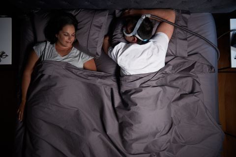 Man sleeping on stomach with AirFit N30i nasal CPAP mask (Photo: Business Wire)