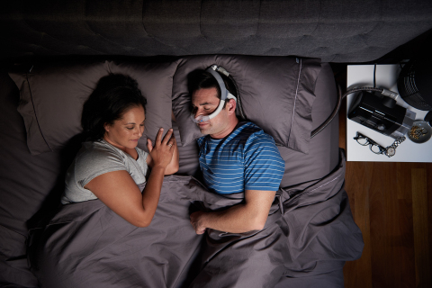 Man sleeping on side with AirFit N30i nasal CPAP mask (Photo: Business Wire)