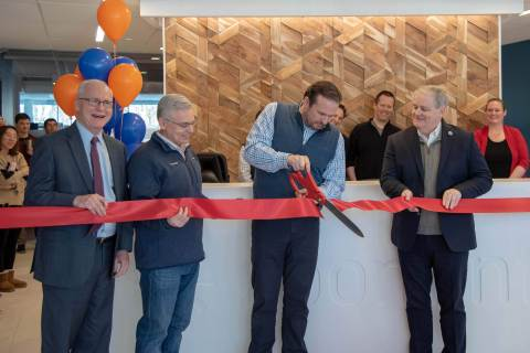 [L-R]: State Senator Michael J. Barrett; ZoomInfo CFO, John Rogers; ZoomInfo CEO Derek Schoettle; and State Rep. Thomas M. Stanley cut the ribbon at ZoomInfo's new corporate headquarters on Tuesday, January, 22, 2019. (Photo: Business Wire).