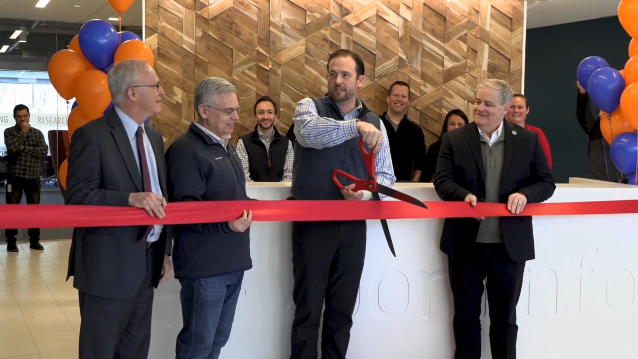 ZoomInfo CEO Derek Schoettle cuts the ribbon at ZoomInfo's new corporate headquarters on Jan. 22, 2019.