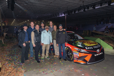 Left to right: Professional Bull Riding legend Luke Snyder, Textron CEO Scott Donnelly; Textron Specialized Vehicles Inc. CEO Scott Ernest, country music star Luke Bryan, fishing legend Jimmy Houston, NFL Super Bowl Champion Peyton Manning, TRACKER Founder Johnny Morris, and NASCAR Champion Martin Truex, Jr. alongside his #19 Bass Pro Shops, TRACKER Boats and ATVs Toyota Camry set to debut at the Daytona 500 next month. (Photo: Business Wire)