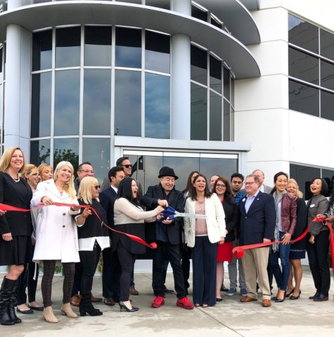 Behind the ribbon cutting ceremony: TLC team, Founder and President, Tilly Levine, board members, Tillys Co-Founder and Chairman of the Board, Hezy Shaked, and various city officials (Photo: Business Wire)