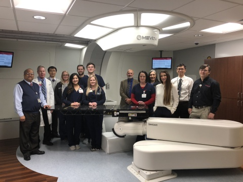 The teams from OU Medicine and Mevion gather to celebrate the first patient treatment. (Photo: Business Wire)