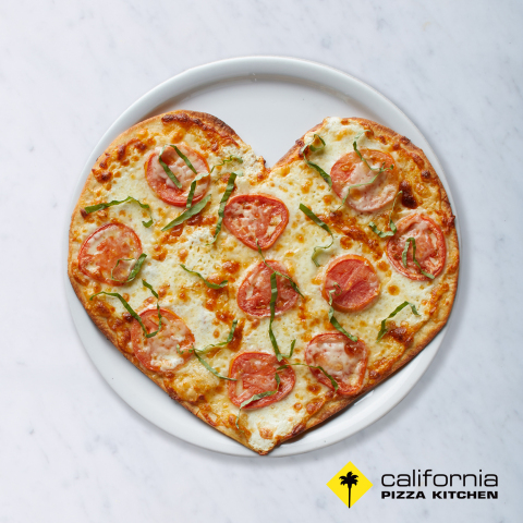 Heart-shaped pizzas are available at California Pizza Kitchen Feb. 13-17. Guests can order any pizza variety on the special crispy thin crust. (Photo: Business Wire)