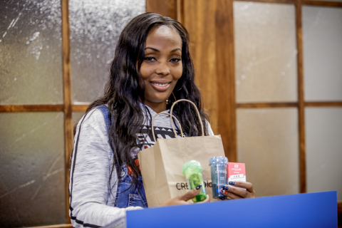 Illinois alternative to opioid patient Tashena Altman makes first medical cannabis purchase under Illinois new law. (Photo: Business Wire)